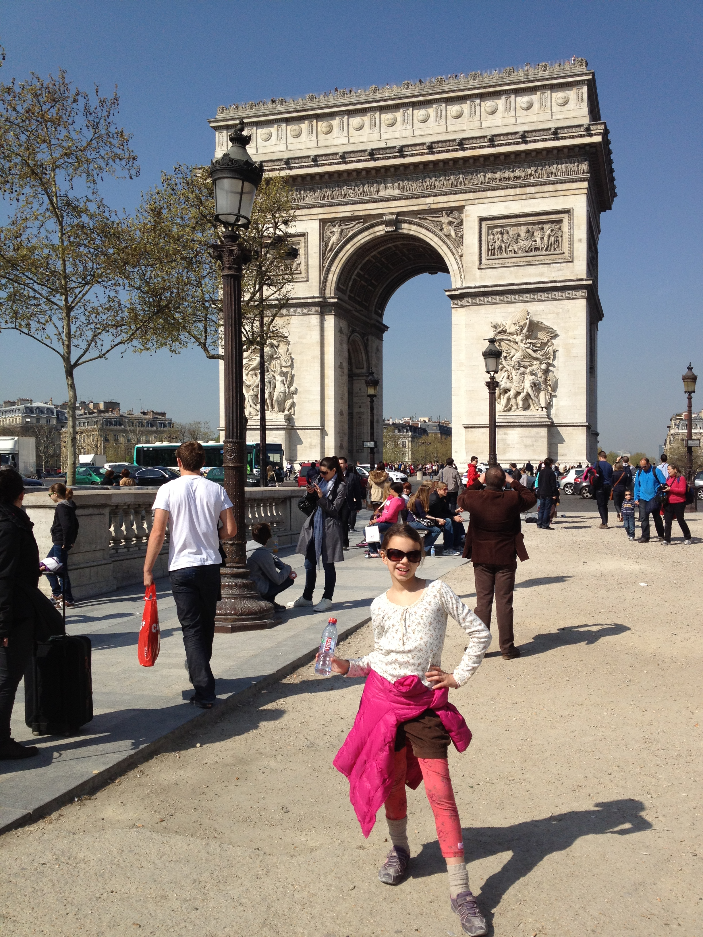 Photograph of young girl in front of Arc de Triomphe in Paris