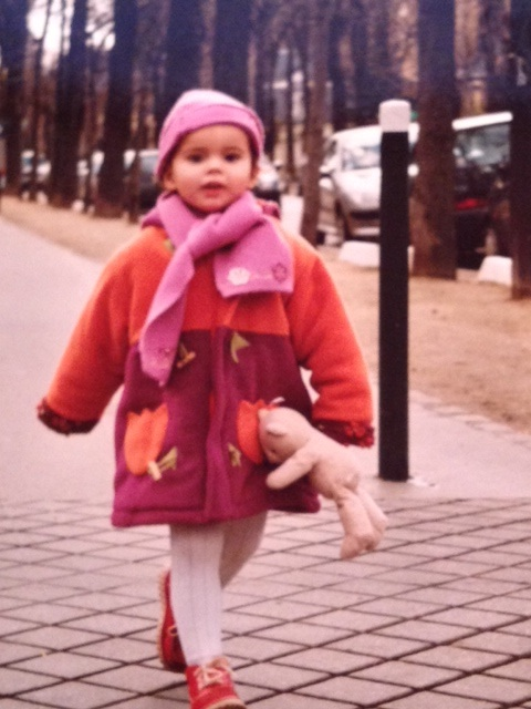 Two-year-old girl walking Parisian streets