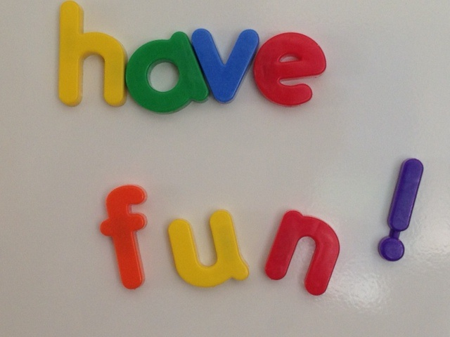 Image of magnetic letters spelling having fun on a fridge