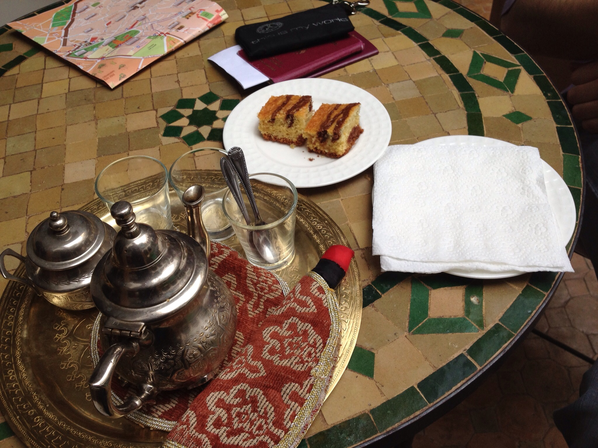 Silver tea pot and pastries