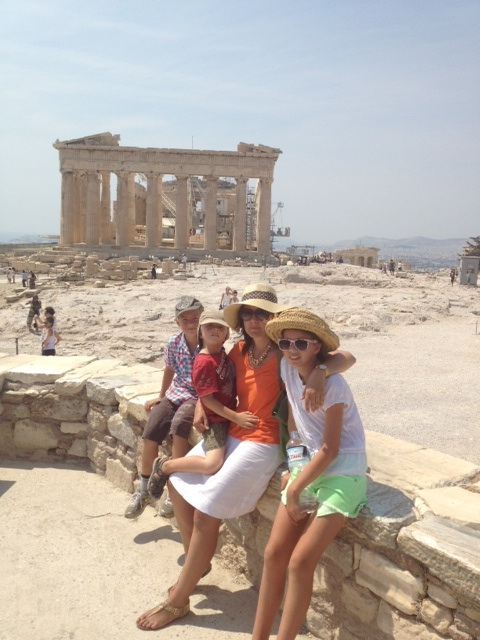 Family in fornt of Akropolis in Athens