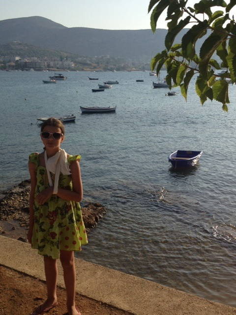 Girl with arm in sling in Porto Rafti Bay
