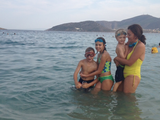 Family in the water at Porto Rafti