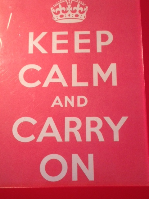 Poster of white text on red stating keep Calm and Carry On