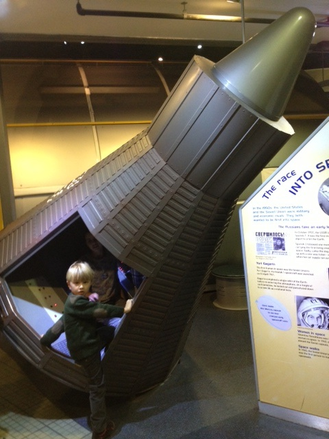 Boy entering space rocket