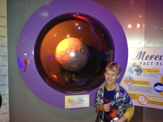 Boy in front of display at National Space Centre