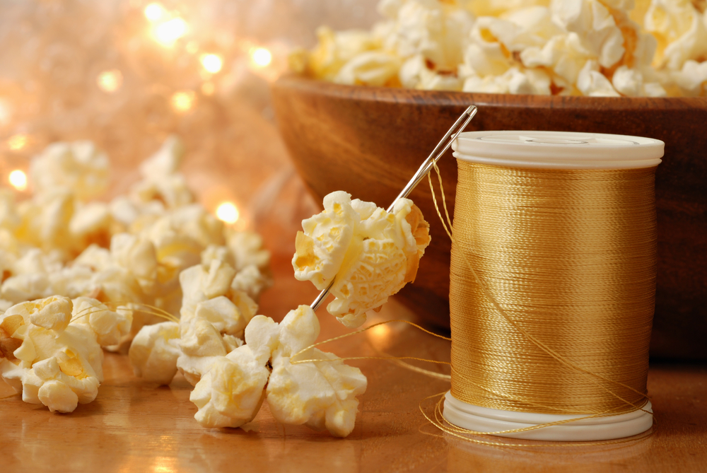 popcorn on a golden string for Christmas tree