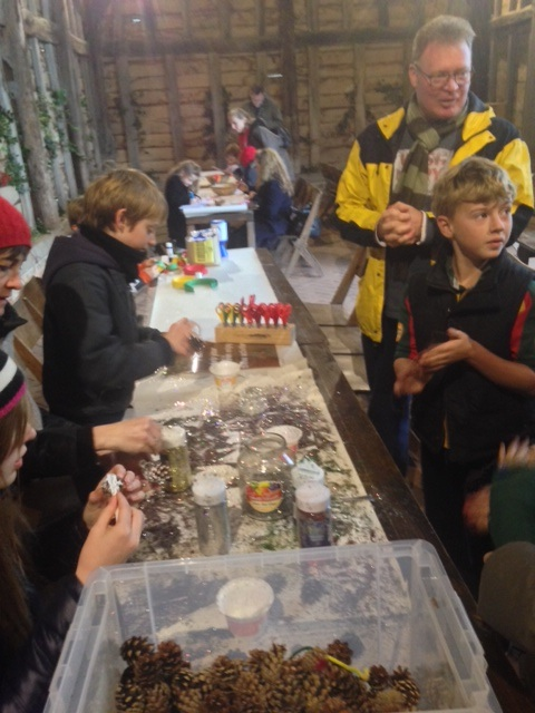 Children making Christmas decorations at Chiltern Open Air Museum