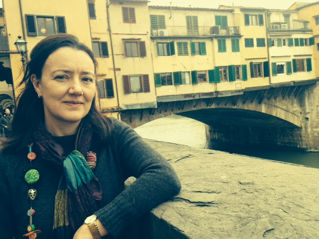 Woman in front of Ponte Vecchio bridge in Italy