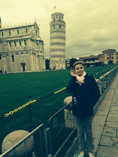 Girl in front of leaning tower of Pisa